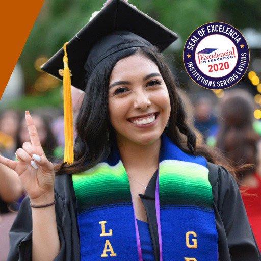 Student in graduate attire flashing hook 'em horns sign with Seal of Excelencia image in corner