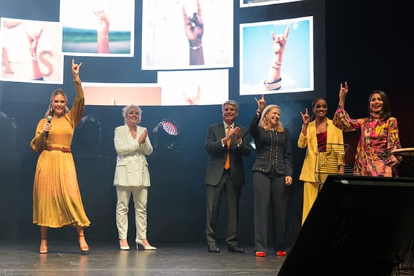 Kendra Scott and guests stand on stage after the announcement of the Kendra Scott Women's Entrepreneurial Leadership (WEL) Institute