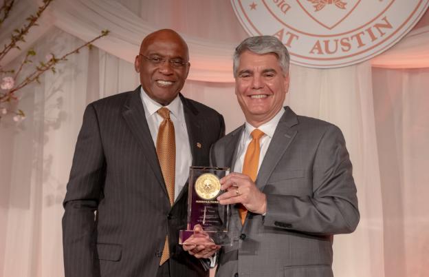 President Fenves giving an award.