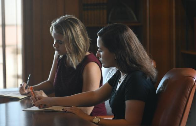 President's Student Advisory Committee Leadership takes notes in President's Office